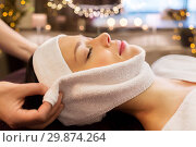 Купить «woman having face massage with towel at spa», фото № 29874264, снято 26 января 2017 г. (c) Syda Productions / Фотобанк Лори