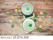 Купить «glasses of green beer with shamrock from top», фото № 29874308, снято 31 января 2018 г. (c) Syda Productions / Фотобанк Лори
