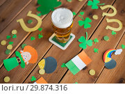 Купить «glass of beer and st patricks day party props», фото № 29874316, снято 31 января 2018 г. (c) Syda Productions / Фотобанк Лори