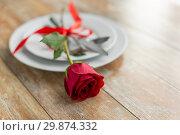 Купить «close up of red rose flower on set of dishes», фото № 29874332, снято 9 февраля 2018 г. (c) Syda Productions / Фотобанк Лори