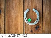 Купить «horseshoe with shamrock on wooden background», фото № 29874428, снято 31 января 2018 г. (c) Syda Productions / Фотобанк Лори