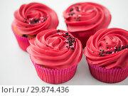 Купить «close up of cupcakes with red buttercream frosting», фото № 29874436, снято 8 февраля 2018 г. (c) Syda Productions / Фотобанк Лори