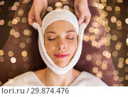 Купить «woman having face massage with towel at spa», фото № 29874476, снято 26 января 2017 г. (c) Syda Productions / Фотобанк Лори