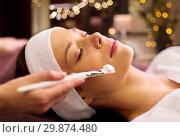 Купить «beautician applying facial mask to woman at spa», фото № 29874480, снято 26 января 2017 г. (c) Syda Productions / Фотобанк Лори