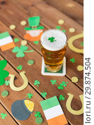 Купить «glass of beer and st patricks day party props», фото № 29874504, снято 31 января 2018 г. (c) Syda Productions / Фотобанк Лори