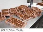 Купить «chocolate in candy molds at confectionery shop», фото № 29874580, снято 4 декабря 2018 г. (c) Syda Productions / Фотобанк Лори