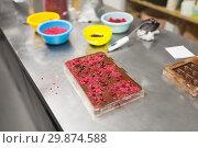 Купить «chocolate with berries at confectionery shop», фото № 29874588, снято 4 декабря 2018 г. (c) Syda Productions / Фотобанк Лори