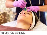 Купить «woman having microdermabrasion facial treatment», фото № 29874620, снято 26 января 2017 г. (c) Syda Productions / Фотобанк Лори
