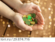 Купить «hands with golden coins and shamrock leaf», фото № 29874716, снято 31 января 2018 г. (c) Syda Productions / Фотобанк Лори
