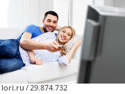Купить «happy smiling couple watching tv at home», фото № 29874732, снято 9 февраля 2014 г. (c) Syda Productions / Фотобанк Лори
