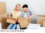 Купить «happy couple unpacking boxes at new home», фото № 29874816, снято 25 февраля 2016 г. (c) Syda Productions / Фотобанк Лори