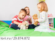 Купить «happy children playing with soft toys at home», фото № 29874872, снято 15 октября 2017 г. (c) Syda Productions / Фотобанк Лори