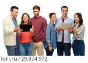 Купить «group of smiling friends with tablet computers», фото № 29874972, снято 10 ноября 2018 г. (c) Syda Productions / Фотобанк Лори
