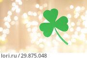 Купить «green paper shamrock over festive lights», фото № 29875048, снято 31 января 2018 г. (c) Syda Productions / Фотобанк Лори