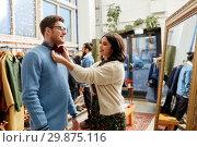 Купить «couple choosing bowtie at vintage clothing store», фото № 29875116, снято 30 ноября 2017 г. (c) Syda Productions / Фотобанк Лори