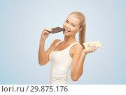 Купить «happy woman eating dark chocolate instead of white», фото № 29875176, снято 23 марта 2013 г. (c) Syda Productions / Фотобанк Лори