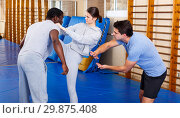 Купить «People fighting with coach at gym», фото № 29875408, снято 31 октября 2018 г. (c) Яков Филимонов / Фотобанк Лори