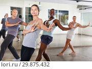 Купить «People dancing lindy hop during group training», фото № 29875432, снято 30 июля 2018 г. (c) Яков Филимонов / Фотобанк Лори