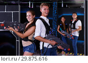 Купить «Guy and girl are happy with their victory in laser tag game», фото № 29875616, снято 27 августа 2018 г. (c) Яков Филимонов / Фотобанк Лори