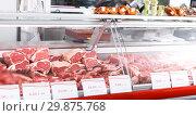 Купить «Meat displayed for sale in shop», фото № 29875768, снято 22 июня 2018 г. (c) Яков Филимонов / Фотобанк Лори