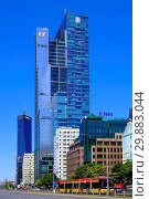 Купить «Warsaw, Masovia / Poland - 2018/06/08: Panoramic view of city center with modern skyscrapers - Rondo One R1 at ONZ roundabout and Q22 at 22 Jana Pawla II street», фото № 29883044, снято 19 февраля 2020 г. (c) age Fotostock / Фотобанк Лори