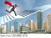 Купить «Superhero businessman climbing career ladder», фото № 29886572, снято 16 октября 2019 г. (c) Elnur / Фотобанк Лори