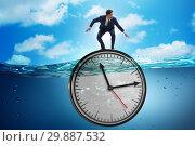 Купить «Businessman in deadline and time management concept», фото № 29887532, снято 19 марта 2019 г. (c) Elnur / Фотобанк Лори