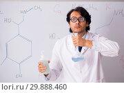 Купить «Young funny chemist in front of white board», фото № 29888460, снято 9 октября 2018 г. (c) Elnur / Фотобанк Лори