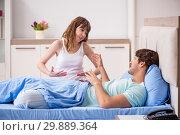Купить «Young couple in the bedroom», фото № 29889364, снято 19 сентября 2018 г. (c) Elnur / Фотобанк Лори