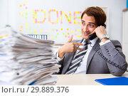 Купить «Young handsome employee sitting at the office», фото № 29889376, снято 5 сентября 2018 г. (c) Elnur / Фотобанк Лори
