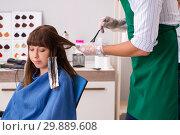 Купить «Young woman visiting young handsome barber», фото № 29889608, снято 9 августа 2018 г. (c) Elnur / Фотобанк Лори