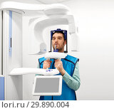 Купить «patient having x-ray scanning at dental clinic», фото № 29890004, снято 22 апреля 2018 г. (c) Syda Productions / Фотобанк Лори
