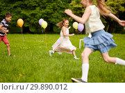 Купить «happy kids playing tag game at birthday party», фото № 29890012, снято 27 мая 2018 г. (c) Syda Productions / Фотобанк Лори