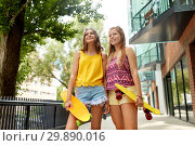 Купить «teenage girls with short skateboards in city», фото № 29890016, снято 19 июля 2018 г. (c) Syda Productions / Фотобанк Лори