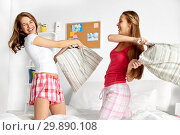 Купить «happy teen girl friends fighting pillows at home», фото № 29890108, снято 14 ноября 2015 г. (c) Syda Productions / Фотобанк Лори