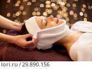 Купить «woman having face massage with towel at spa», фото № 29890156, снято 26 января 2017 г. (c) Syda Productions / Фотобанк Лори