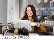 Купить «happy woman with map drinking cocoa at city cafe», фото № 29890260, снято 12 мая 2016 г. (c) Syda Productions / Фотобанк Лори