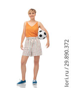 Купить «smiling teenage girl with soccer ball», фото № 29890372, снято 30 июня 2018 г. (c) Syda Productions / Фотобанк Лори