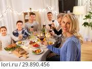 Купить «happy family having dinner party at home», фото № 29890456, снято 15 декабря 2018 г. (c) Syda Productions / Фотобанк Лори