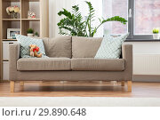 Купить «sofa with cushions at cozy home living room», фото № 29890648, снято 23 июля 2018 г. (c) Syda Productions / Фотобанк Лори