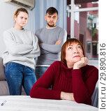 Купить «Chagrined senior woman in quarrel with young couple», фото № 29890816, снято 27 ноября 2017 г. (c) Яков Филимонов / Фотобанк Лори