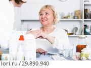 Купить «MAture woman and doctor», фото № 29890940, снято 14 ноября 2017 г. (c) Яков Филимонов / Фотобанк Лори