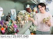 Купить «Mature woman near souvenirs shelves», фото № 29891040, снято 20 июня 2019 г. (c) Яков Филимонов / Фотобанк Лори