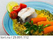 Купить «Steamed hake by served with vegetable pate, boiled carrots, lemon and greens», фото № 29891112, снято 17 июля 2019 г. (c) Яков Филимонов / Фотобанк Лори