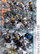 Image of stand with fine baitcasting reel. Стоковое фото, фотограф Яков Филимонов / Фотобанк Лори