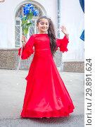 Купить «Russia, Samara, May 2018. A girl in a beautiful dress at a festive procession of graduates of schools.», фото № 29891624, снято 24 мая 2018 г. (c) Акиньшин Владимир / Фотобанк Лори