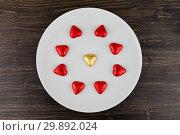 Купить «Abstract chocolate candies in hearts shape on white plate», фото № 29892024, снято 5 февраля 2019 г. (c) Kira_Yan / Фотобанк Лори