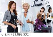 Купить «Smiling elderly woman with hairdresser», фото № 29898532, снято 26 июня 2018 г. (c) Яков Филимонов / Фотобанк Лори