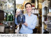 Купить «adults woman chooses glass decorative bottles», фото № 29898832, снято 22 ноября 2017 г. (c) Яков Филимонов / Фотобанк Лори