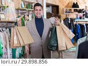 Купить «Man is satisfied shopping», фото № 29898856, снято 12 марта 2018 г. (c) Яков Филимонов / Фотобанк Лори